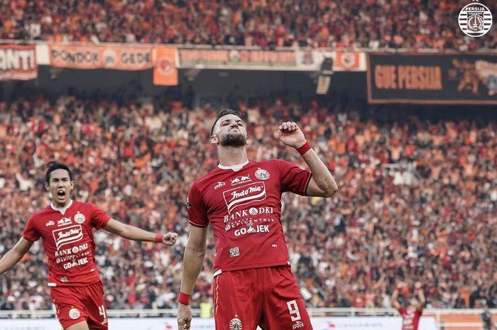 Striker Persija Jakarta, Marko Simic, melakukan selebrasi setelah mencetak gol ke gawang Persib Bandung pada pekan kedelapan Liga 1 2019.