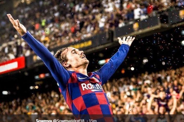 Antoine Griezmann melakukan selebrasi setelah sukses menyarangkan gol keduanya pada pertandingan Barcelona melawan Real Betis di Stadion Camp Nou pada pekan kedua Liga Spanyol 2019-2020, Minggu (25/8/2019).