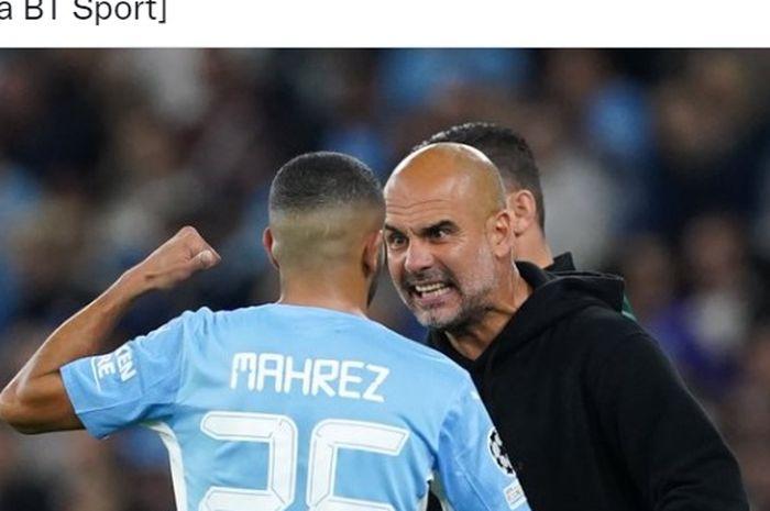 Pelatih Manchester City, Pep Guardiola, sedang mengomeli Riyad Mahrez.