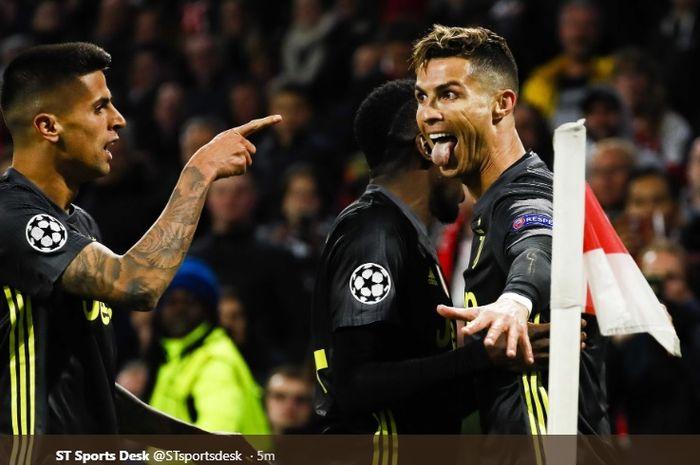 Cristiano Ronaldo merayakan gol bersama Blaise Matuidi dan Joao Cancelo usai bobol gawang Ajax Amsterdam