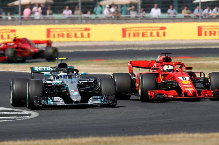Valtteri Bottas yang tengah memimpin GP F1 Inggris, mendapat tekanan dari Sebastian Vettel