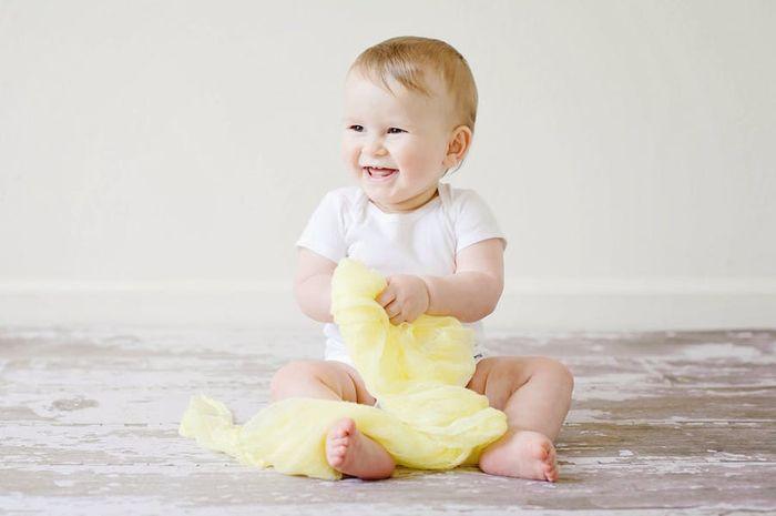 Gigi Si Kecil Berwarna Kuning Yuk Moms Ketahui Penyebabnya Semua