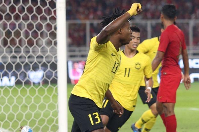 Momen saat pemain Malaysia, Mohamadou Sumareh (#13), merayakan golnya ke gawang Indonesia dalam laga kualifikasi Piala Dunia 2022 Zona Asia, Kamis (5/9/2019).
