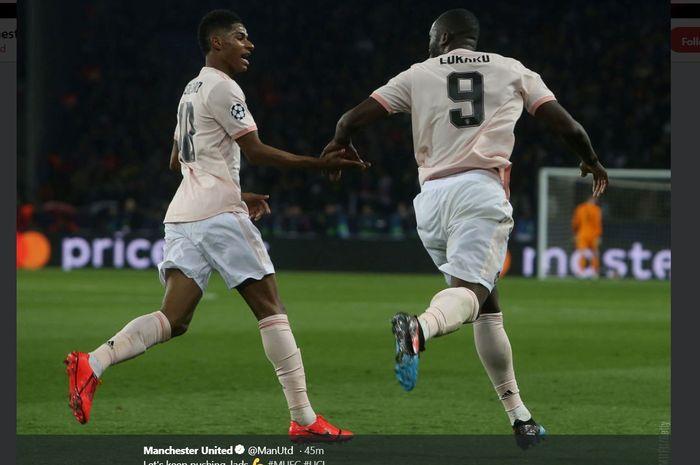 Striker Manchester United, Marcus Rashford, melakukan selebrasi seusai menjcetak gol ke gawang PSG dalam laga di Parc des Princess, Rabu (6/3/2019)