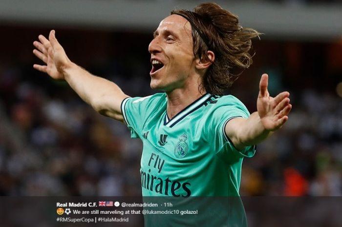 Gelandang Real Madrid, Luka Modric, melakukan selebrasi setelah menjebol gawang Valencia pada semifinal Piala Super Spanyol, Rabu (8/1/2020).