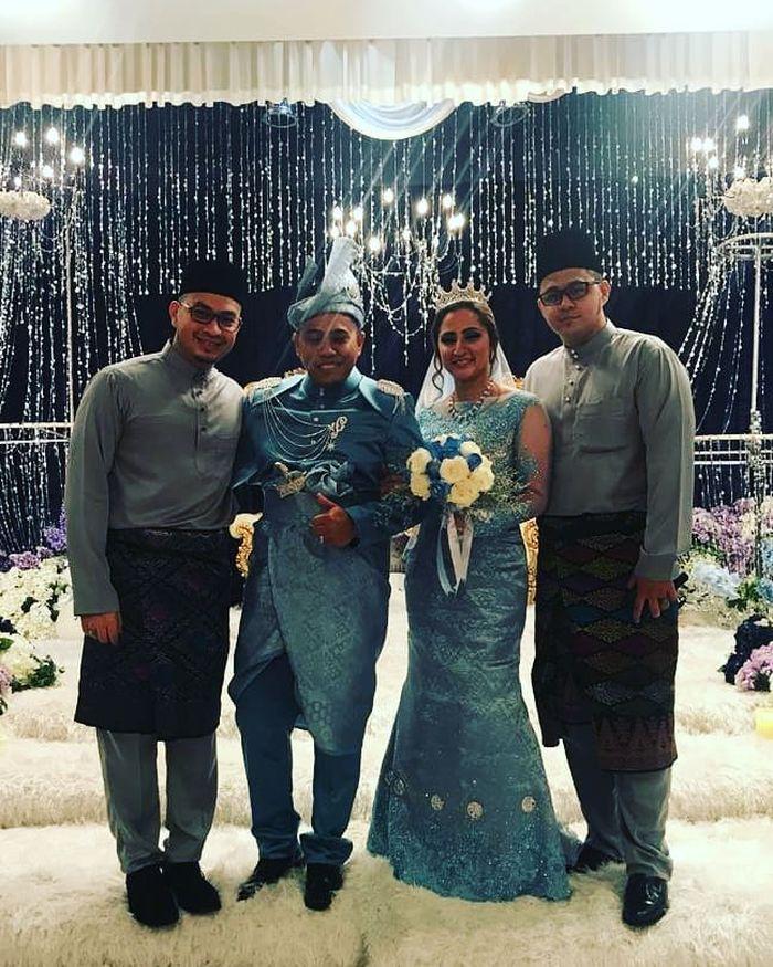 Bubu mengenakan pakaian khas Malaysia